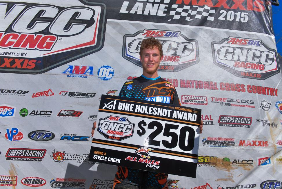 Jordan Ashburn took the early lead with the $250 All Balls Racing Holeshot Award Photo: Ken Hill