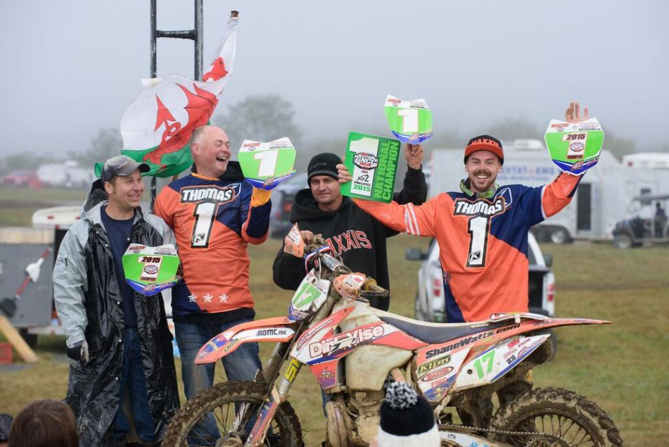 Newly crowned 2015 XC2 Pro Lites class champion, Jason Thomas, celebrates with his dad. Photo: Ken Hill