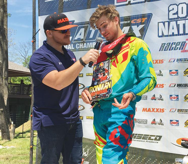 ATVMX announcer and Crawfordsville resident Mikey Waynes interview ATVMX racer Noah Mickelson on the winners podium on Sunday.