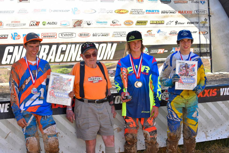 John Penton pictured with the youth overall podium: Zack Davidson, Peyton Whipkey and Mack Riemer.