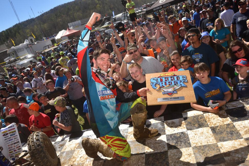 After receiving some help from the GNCC Mud Fleas during the race,Walker Fowler celebrates his win with the North Carolina crowd.