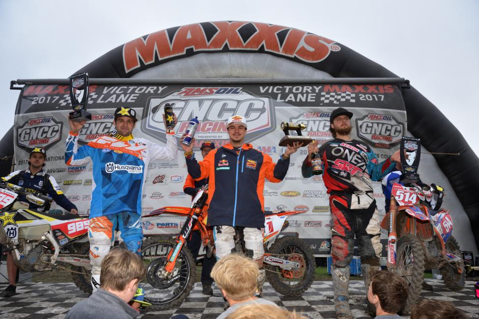 *Provisional* Overall Podium: (2) Thad Duvall, (1) Kailub Russell, (3) Steward Baylor.