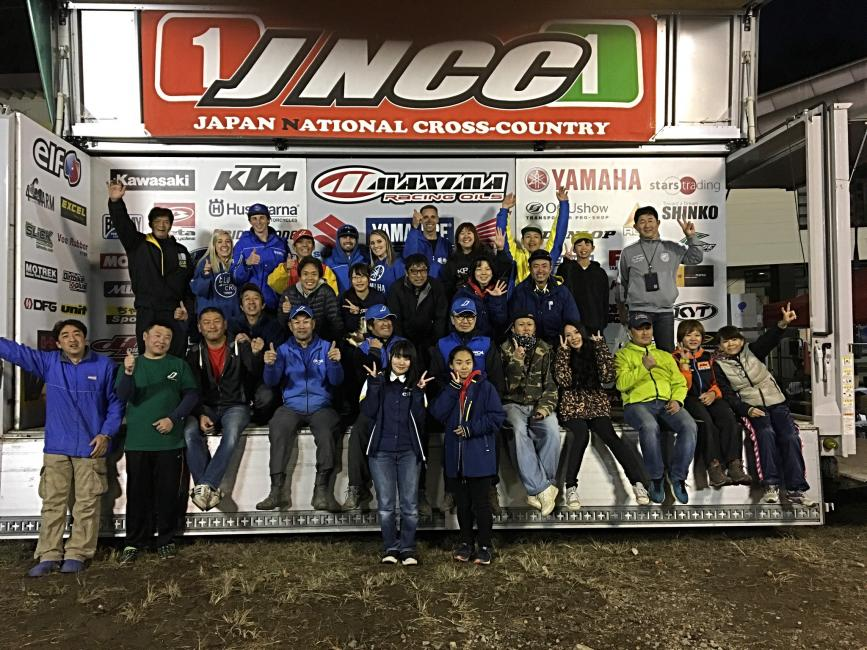 The JNCC and GNCC families celebrate Ricky Russell's win on the podium.
