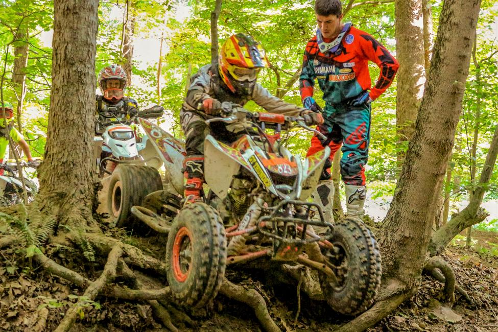 GNCC ATV National Champion, Walker Fowler, stand by to help the youth riders in the woods.