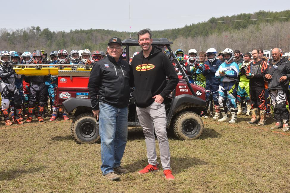 Racer Productions Director, Tim Cotter and Kurt Caselli Foundation President, Donny Emler Jr. with the new safety vehicle with pro riders at the FMF Steele Creek GNCC.