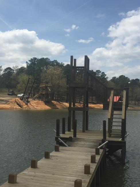 Mr. Henry is at it again! Moree's Sportsman Preserve installed 2 zip lines into the pond, upgraded the rope swing platform and pouring the concrete for a water slide. The Camp Coker Swimming Hole is getting a makeover!