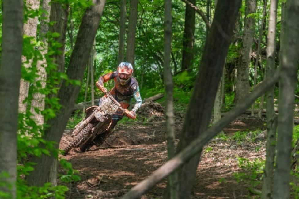 Ben Kelley carving through the trees on his KTM 250 XC-F.