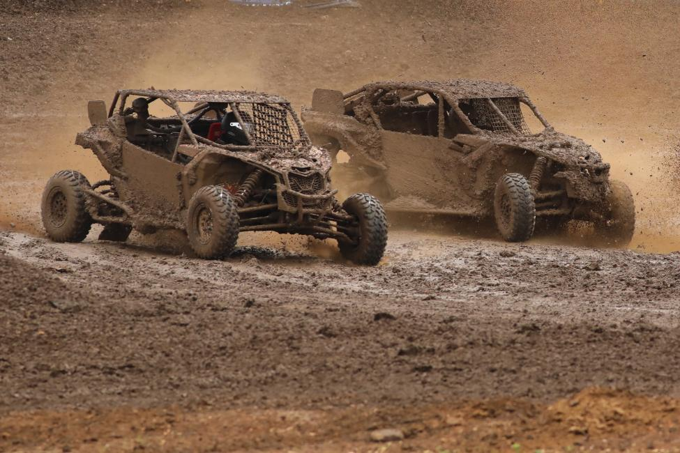 A very mud-covered Tim Farr (left) and Kyle Chaney battled for the win all the way to the checkers in their Can-Am Maverick X3 side-by-side vehicles at round five. Farr ended up with the victory, his first this year.