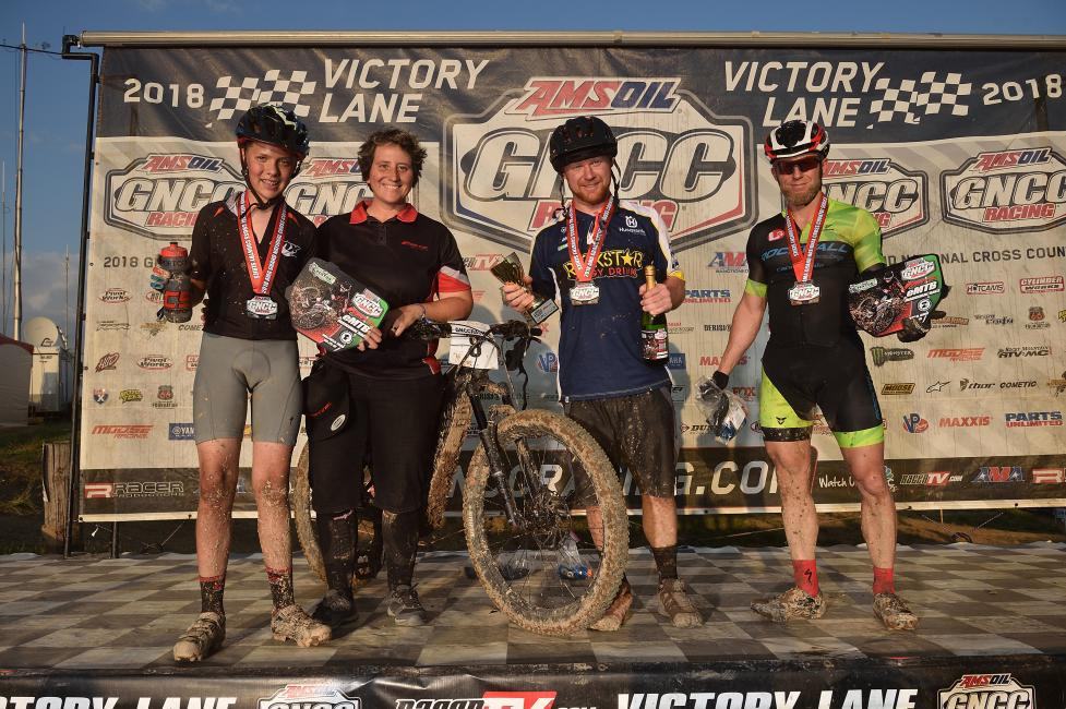 Bau pictured with the Fantic eMTB race top three from The Wiseco John Penton GNCC.