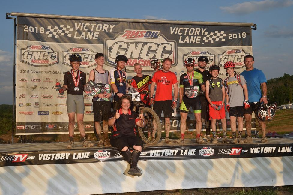 Bau pictured with the first-ever Fantic eMTB race athletes from The Wiseco John Penton GNCC.