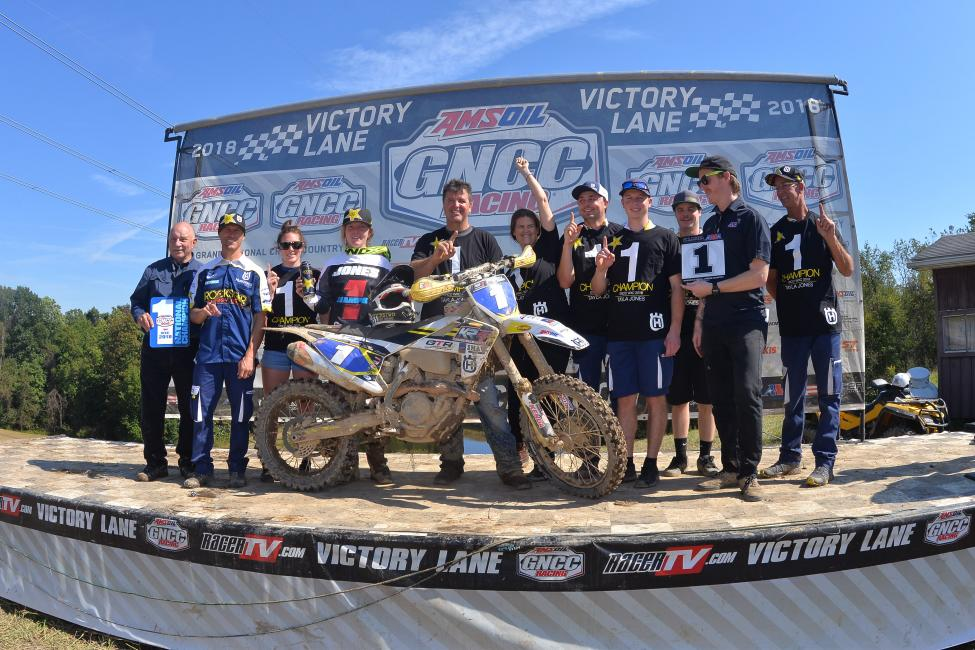 Jones pictured with her team and supporters at the 2018 Mason-Dixon GNCC as she is presented her number one plates.