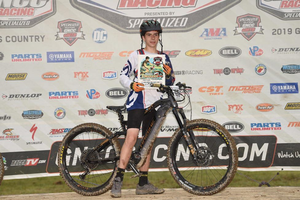 Talon on the podium after earning the Youth eMTB class win.