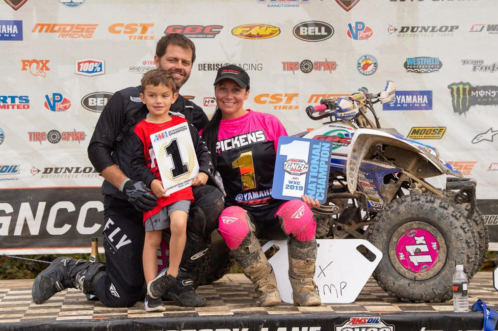 Pickens celebrates with her husband, and son, who also race the GNCC Series.