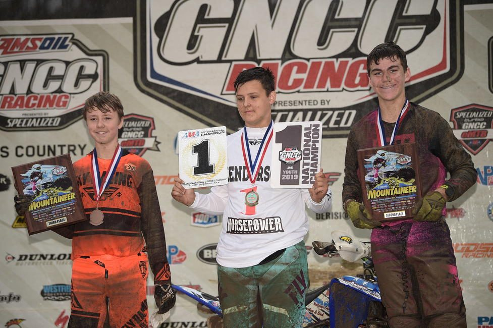Parker Henderson (center) earned the Youth Overall ATV National Championship. Charlie Stewart (right) and Tyler Cox (left) rounded out the 8 a.m. youth overall podium.