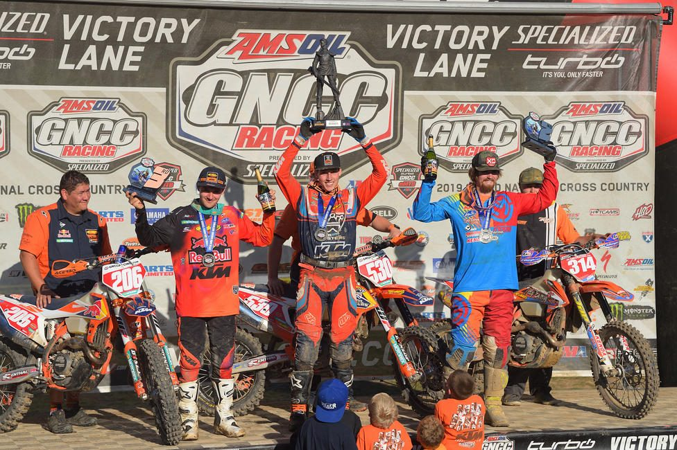 Kelley (center) came away with his first-ever career overall and XC1 class win at round 12 of the GNCC Series.
