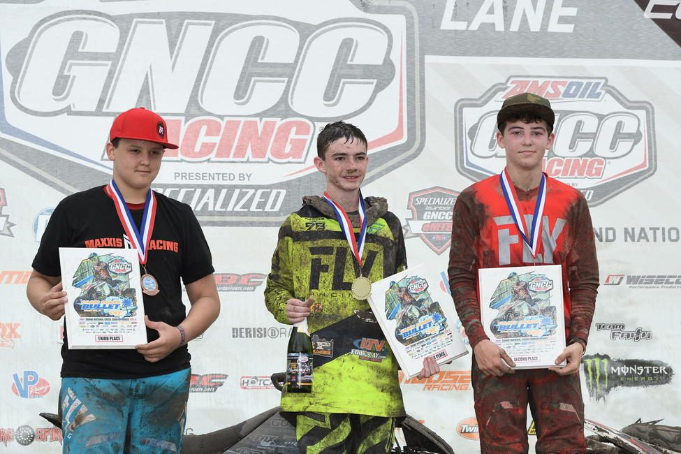 Hawkins (center) after his win at the Camp Coker Bullet GNCC in South Carolina.