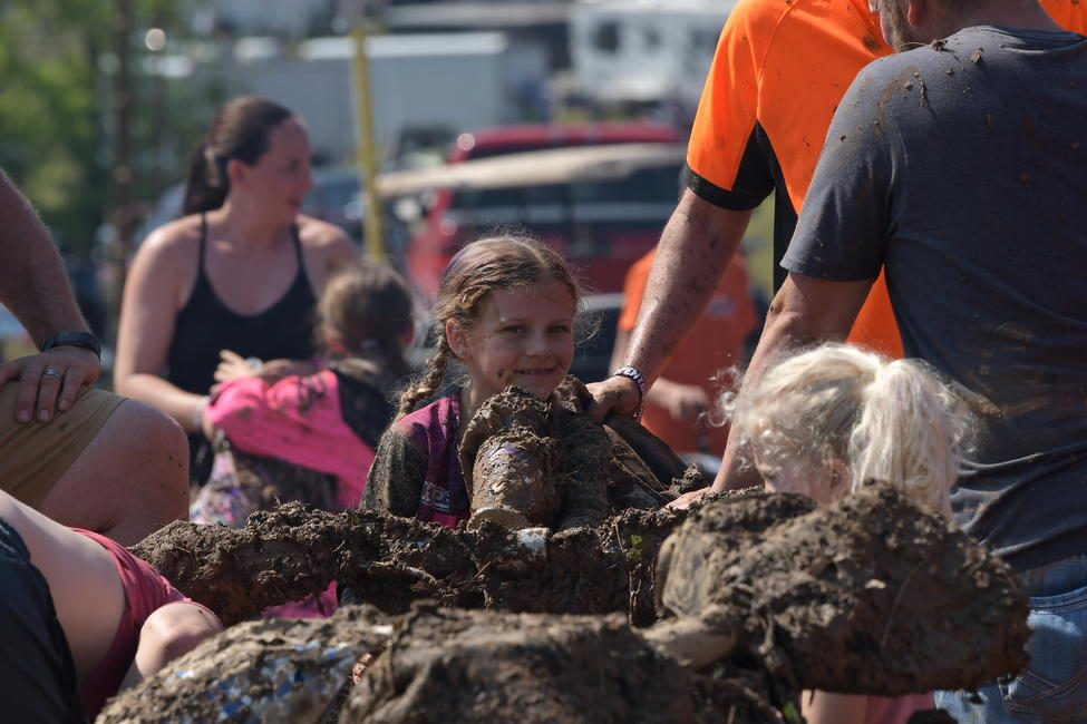 Khyler shares a smile after a muddy GNCC race is completed.