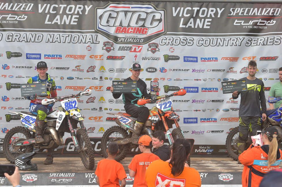 Zack Hayes (center) earned the FMF XC3 125 Pro-Am class win.