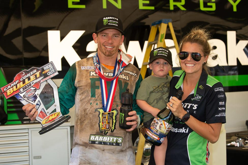 Strang pictured with his wife, Cameron, and son Maverick after winning the Camp Coker Bullet GNCC.