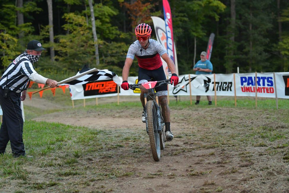 Specialized's Charlie Mullins came through the finish with over a minute lead to take the Specialized Turbo eMTB overall win.