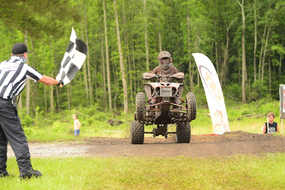 Cox taking the checkered flag back at the Camp Coker Bullet GNCC. Photo: Ken Hill